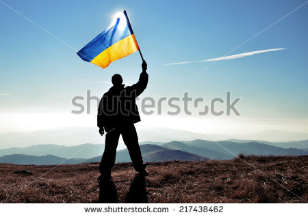 stock-photo-successful-silhouette-man-winner-waving-ukrainian-flag-on-top-of-the-mountain-peak-217438462