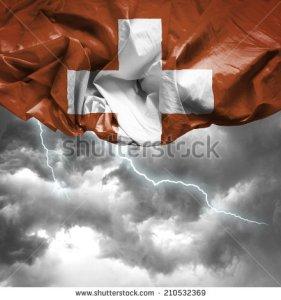 stock-photo-switzerland-waving-flag-on-a-bad-day-210532369