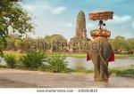 stock-photo-tourists-on-an-elephant-ride-tour-of-the-ancient-city-ayutaya-thailand-195893810