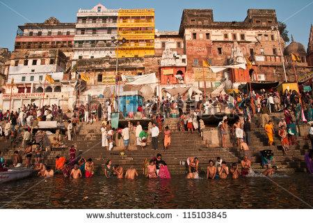 stock-photo-varanasi-india-february-hindu-pilgrims-take-holy-bath-in-the-river-ganges-on-the-auspicious-115103845