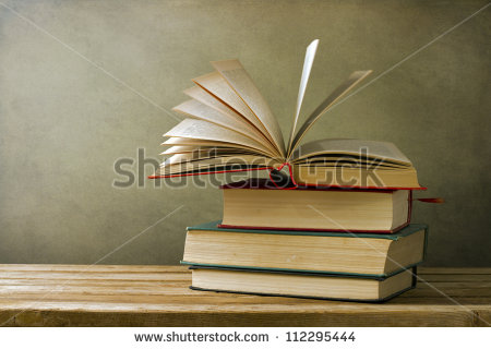 stock-photo-vintage-old-books-on-wooden-deck-table-and-grunge-background-112295444