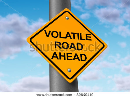 stock-photo-volatility-in-the-stock-market-symbol-represented-by-a-yellow-road-warning-sign-showing-the-hazards-82649419