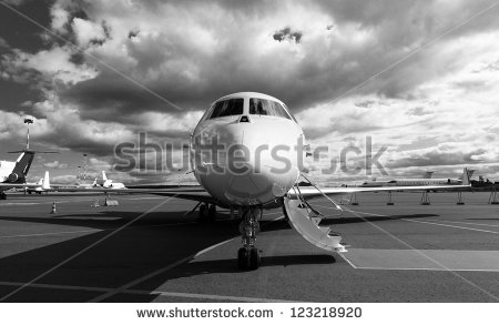 stock-photo-white-reactive-private-jet-the-front-landing-gear-and-gangways-123218920