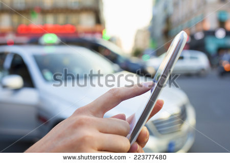 stock-photo-woman-orders-a-taxi-from-her-mobile-phone-223777480