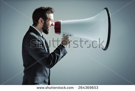 stock-photo-young-businessman-with-a-megaphone-264369653