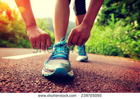 stock-photo-young-woman-runner-tying-shoelaces-239705095 start