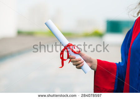 stock-photo-close-up-of-a-folded-diploma-in-hand-of-female-graduate-284078597