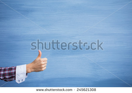 stock-photo-hand-showing-thumbs-up-gesture-on-blue-background-245621308