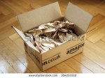 stock-photo-london-united-kingdom-march-opened-amazon-co-uk-shipping-package-parcel-box-on-wooden-304253318