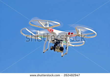 stock-photo-white-drone-hovering-in-a-bright-blue-sky-262482947