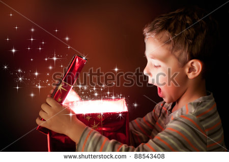 stock-photo-a-surprised-child-opening-and-looking-inside-a-magic-gift-88543408