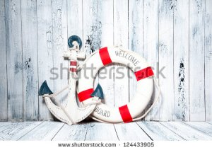 stock-photo-anchor-and-life-buoy-on-a-background-of-white-shabby-wall-boards-124433905