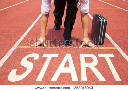 stock-photo-businessman-getting-ready-for-race-on-the-track-258016943 start