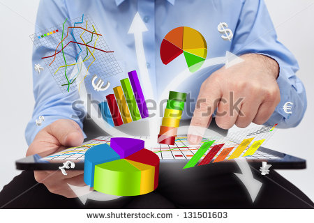 stock-photo-businessman-working-on-tablet-computer-producing-charts-and-reports-131501603