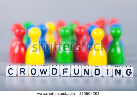 stock-photo-cube-letters-show-crowdfunding-in-front-of-unsharp-ludo-figures-background-is-light-gray-270504203