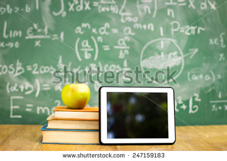 stock-photo-digital-tablet-and-apple-on-the-desk-in-front-of-blackboard-247159183