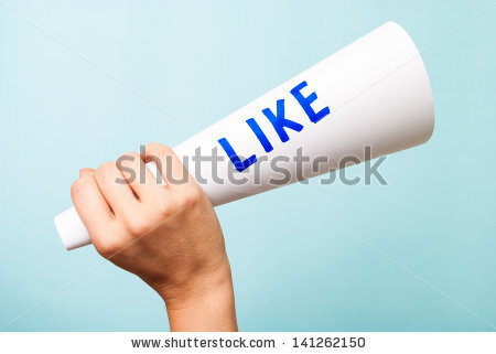 stock-photo-hand-holding-a-paper-white-megaphone-with-the-word-like-on-blue-background-social-media-and-141262150