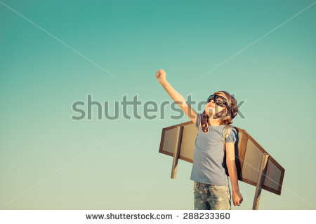 stock-photo-happy-child-playing-with-toy-wings-against-summer-sky-background-retro-toned-288233360