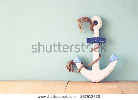 stock-photo-old-nautical-anchor-on-wooden-table-over-wooden-aqua-background-267512420