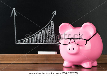stock-photo-pink-piggybank-with-glasses-on-desk-in-front-of-blackboard-showing-graph-259027370