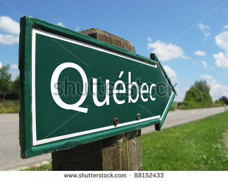 stock-photo-quebec-signpost-along-a-rural-road-88152433