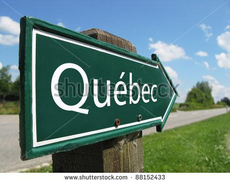 stock-photo-quebec-signpost-along-a-rural-road-88152433