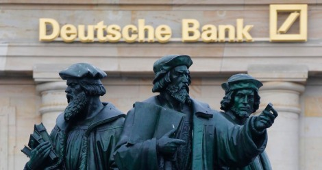 File photo of a statue in front of the former headquarters of Germany's largest business bank, Deutsche Bank in Frankfurt, January 28, 2013. Deutsche Bank, plans to shrink its balance sheet substantially over the next two and a half years to comply with new rules to make banks more crisis-resistant, sources familiar with the bank said July 22, 2013.  REUTERS/Kai Pfaffenbach/Files (GERMANY - Tags: BUSINESS)