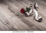 stock-photo-argentine-tango-shoes-and-a-rose-on-a-wooden-floor-caption-tango-argentino-217850299