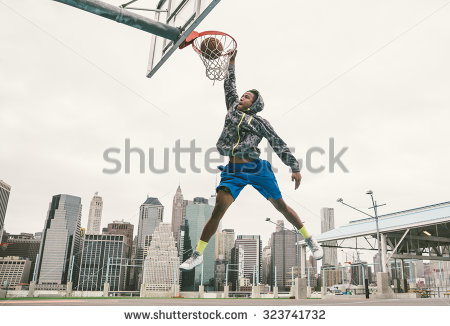 stock-photo-basketball-player-performing-slum-dunk-on-a-street-court-background-with-manhattan-buildings-323741732