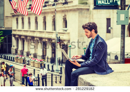 stock-photo-businessman-working-on-street-in-new-york-dressing-in-blue-suit-a-young-guy-with-beard-sitting-281229182
