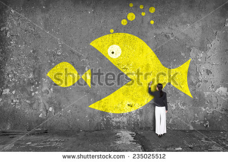 stock-photo-businesswoman-drawing-big-fish-eat-small-fish-on-the-wall-235025512