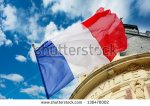 stock-photo-french-flag-waving-over-one-hotel-de-ville-136476002