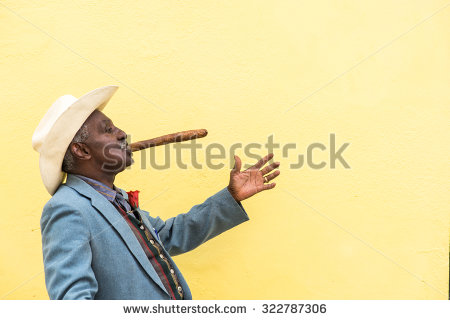 stock-photo-havana-cuba-september-traditional-cuban-man-posing-for-photos-while-smoking-big-cuban-322787306