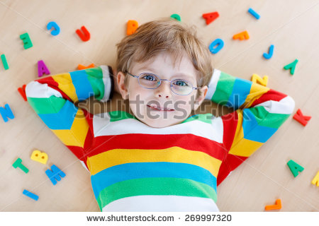 stock-photo-little-kid-boy-in-eyeglasses-playing-with-lots-of-colorful-plastic-letters-indoor-child-wearing-269997320