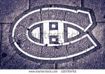 stock-photo-montreal-canada-august-canadien-hockey-team-crest-print-into-the-pavement-in-front-of-bell-220709782 canadiens de montréal