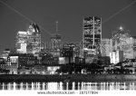 stock-photo-montreal-over-river-at-dusk-with-city-lights-and-urban-buildings-in-black-and-white-167177984
