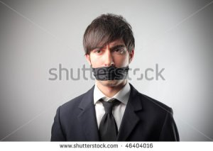 stock-photo-portrait-of-a-businessman-with-a-bandage-on-his-mouth-46404016