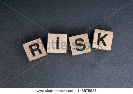 stock-photo-wooden-cubes-with-letters-spelling-risk-143575627