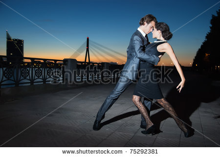 stock-photo-young-couple-dancing-tango-on-the-quay-of-the-river-at-night-75292381