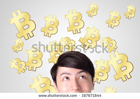 stock-photo-young-man-happy-looking-bitcoin-business-and-bitcoin-concept-167671844
