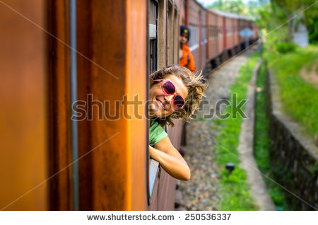 stock-photo-young-woman-traveling-by-train-250536337