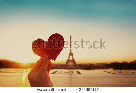 stock-photo-beautiful-vintage-card-from-paris-eiffel-tower-and-hand-with-paper-heart-at-sunrise-244905172