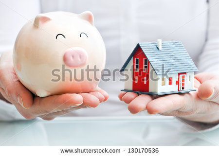 stock-photo-hands-holding-a-piggy-bank-and-a-house-model-housing-industry-mortgage-plan-and-residential-tax-130170536
