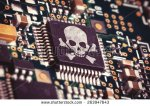 stock-photo-macro-photo-of-a-circuit-board-with-microchip-carrying-a-pirate-symbol-263947643