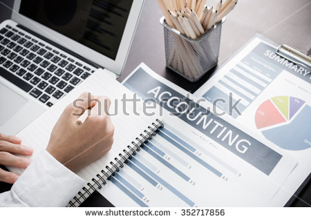 stock-photo-businessman-analyzing-investment-charts-with-laptop-accounting-352717856