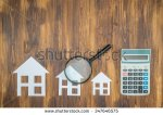 stock-photo-buy-house-mortgage-calculations-calculator-with-magnifier-searching-347646575