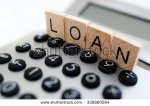 stock-photo-calculator-with-the-word-loan-written-in-wooden-block-letters-330860594