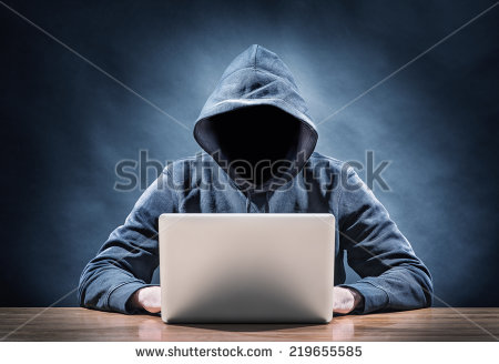 stock-photo-programmer-on-a-computer-219655585 anonymous hacker pirate