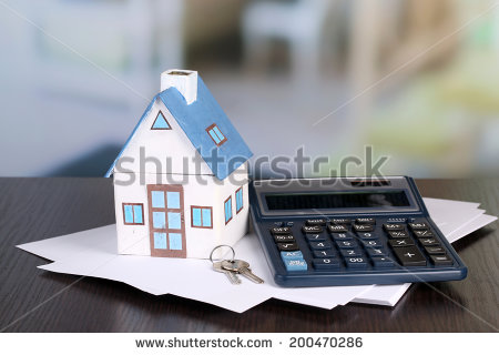 stock-photo-toy-house-and-calculator-on-table-close-up-200470286