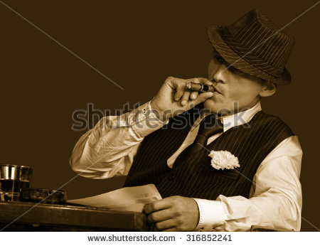 stock-photo-young-gangster-with-hat-smoking-cigar-studio-shot-sepia-toning-316852241